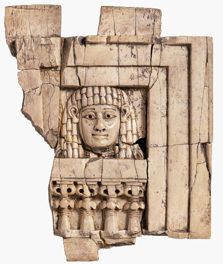 Small piece of carved ivory excavated at ancient Nimrud: it shows the 'Woman at the Window', at a harem? or a temple? Is she human or goddess?