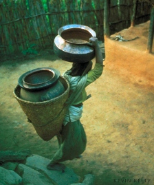 Bible study activities: Photograph by Kevin Kelly, woman carrying water containers
