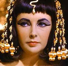 Cleopatra dressed in the royal regalia of a queen; from the movie 'Cleopatra' starring Elizabeth Taylor.