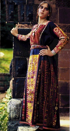 Young Middle Eastern woman in richly embroidered clothing