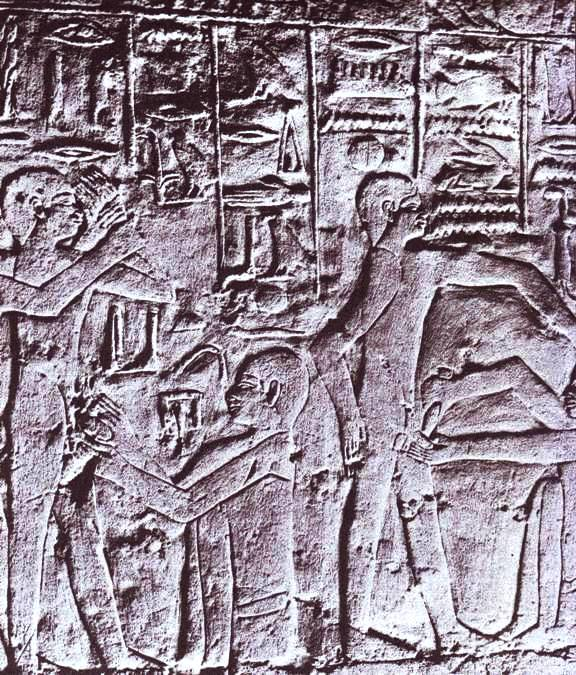 Circumcision in the Bible: Egyptian wall relief showing priests using knives to circumcise two young men