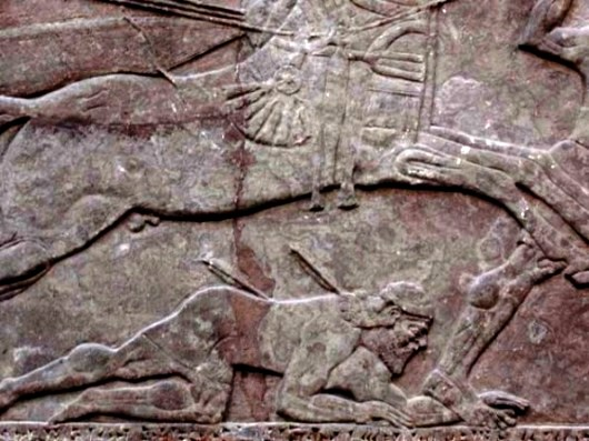 Bible warriors, soldiers: Ahab, husband of Jezebel. Wall carving from the northwest palace at Nimrud: a soldier in battle struck a mortal wound by an arrow; he is trampled underfoot by a chariot horse