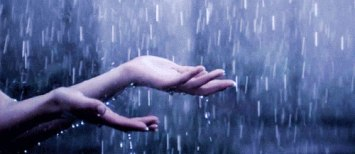 God is One. Hands catching rain