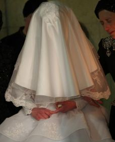 A fully veiled bride at her wedding