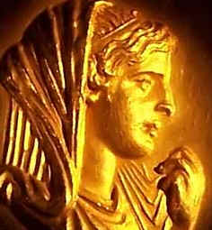 Golden profile of a woman from ancient times