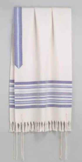 A beautiful hand-woven tallit, or Jewish prayer shawl with fringe