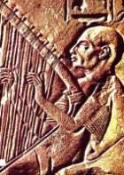 Ancient Egyptian wall carving of a harpist