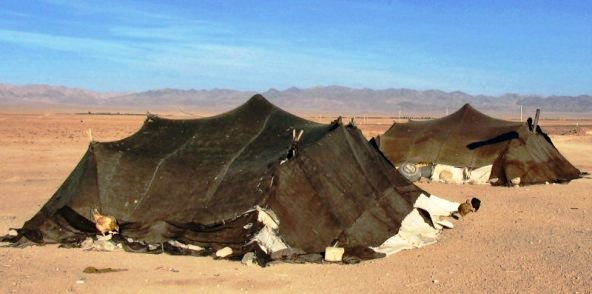 Tents of nomadic herders; women spun the wool, wove the fabric, and sewed the strips together to make the tents they lived in; they also put up and took down the tents whenever the tribe moved from one place to another