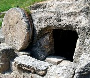Stone tomb with circular door covering rolled away