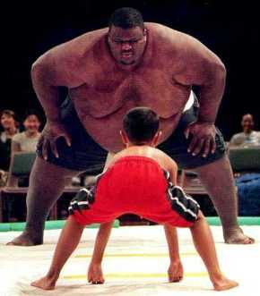 A David and Goliath confrontation: Sumo wrestler faces small boy