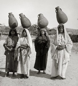 19th century photograph of Palestinian women carrying water jars