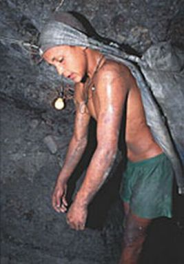 Young boy working in an underground mine
