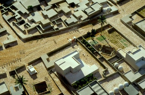 Reconstruction of ancient Egyptian houses, with dome-shaped grain silos