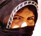 Middle Eastern woman with veil shielding her face