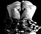 Symbol of Slavery: Hands bound by thick chains
