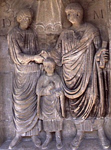 Image of a man, woman and child on a Roman family monument