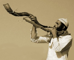 Man blowing the Shofar, photograph by Roie Galitz; this was the horn described in the story of Joshua and the fall of Jericho
