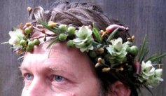 Bible weddings: Man with a garland of flowers in his hair