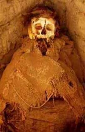 Worst sins in the Bible: lies. A Peruvian mummy in an open grave