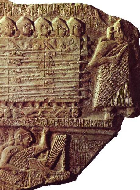 Eannatum, King of Lagash, leads charging troops; he holds a long spear in his left hand and