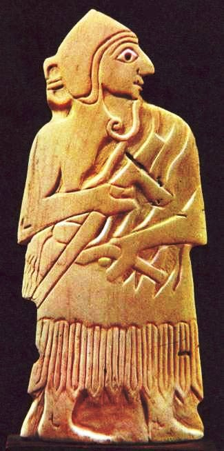 Conch plaque from the temple of Ishtar at Mari. Note the sickle sword held in the soldier's left hand