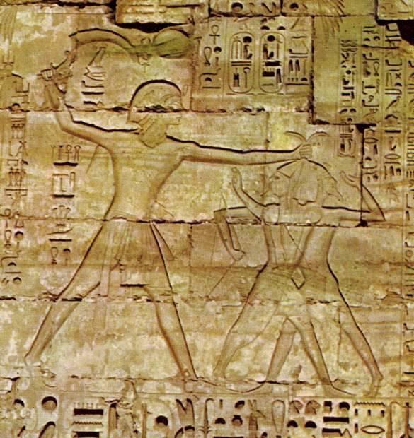 Rameses III kills his enemies with a sickle sword, Medinet Habu, 20th dynasty