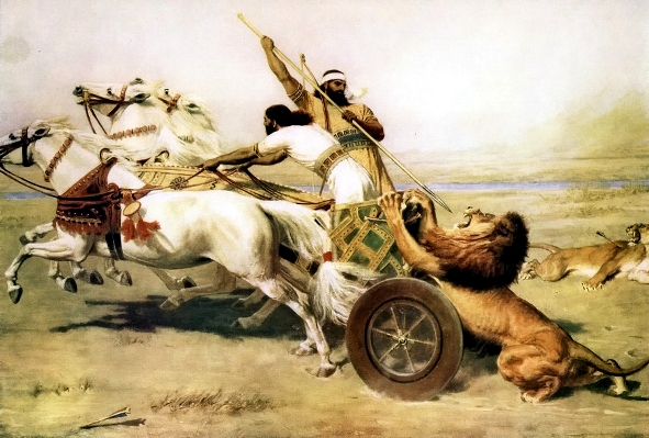 An Assyrian royal lion hunt, showing heavy-wheeled chariot