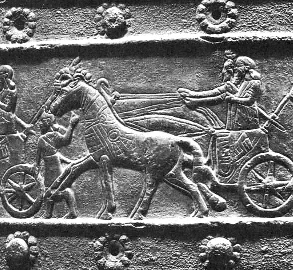 Wall carving of Assyrian chariot horses and their driver