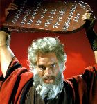 An angry Moses hurls the stone tablets to the ground, breaking them