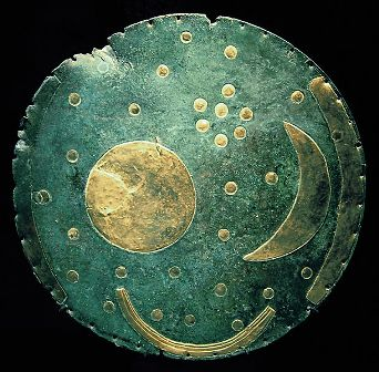 The ancient Nebra Disk showing the Pleiades constellation, used for calculating the correct time for harvesting crops.