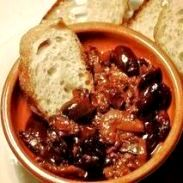 Olives, bread, plate of stew