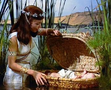 Pharaoh's daughter finds the baby Moses hidden in the bulrushes