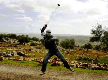 Boy with a slingshot similar to the ones used by the ancient Israelite militia