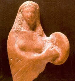Ancient statue of a woman playing a tambourine