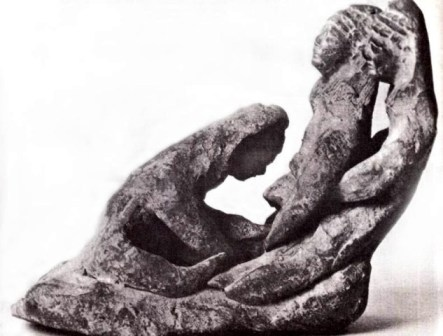 Ancient statuette of a woman giving birth