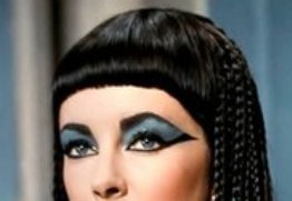 Elaborate eye make-up and wig worn by Queen Cleopatra in the movie 'Cleopatra'