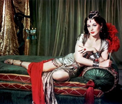 A film still showing Delilah lying on a couch, from the film 'Samson and Delilah'