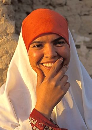 Bible Heroines: Ruth and Naomi. Middle Eastern woman in orange head scarf