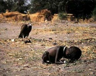 Vulture waiting for a dying child during a terrible drought
