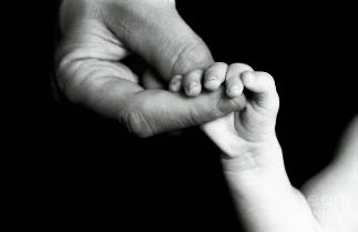God is Father and Mother: someone holding a baby's hand