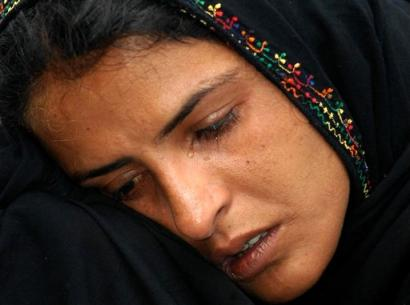Young woman with a grief-stricken face