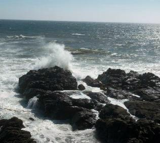 God is cosmic energy. Waves beating on rocks