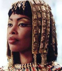Bible Heroines: Queen of Sheba. Beautiful Ethiopian queen with gold headdress and necklace