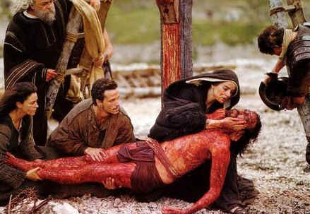 Mary of Nazareth, mother of Jesus, holds her dead son after the crucifixion; from the film The Passion of the Christ