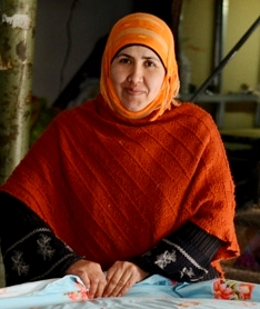 Dorcas-Tabitha. Photograph of a Middle Eastern woman engaged in the task of sewing