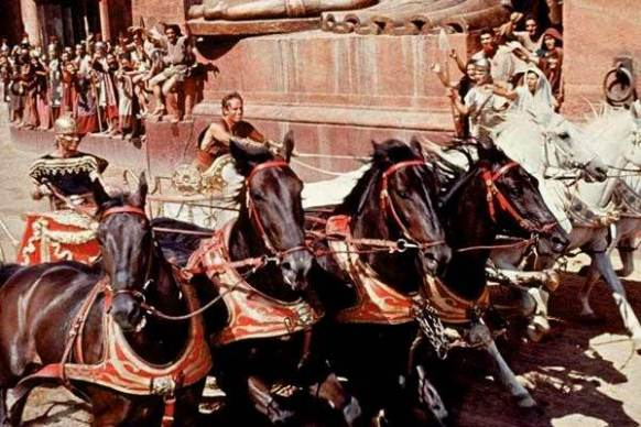 Bible movies, films. Ben Hur and his white chariot horses lead the race in 'Ben Hur'