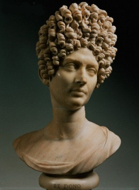 Marble bust of a Roman woman with elaborate hairstyle