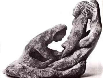 Childbirth in ancient times: Ancient statuette of two midwives helping a woman giving birth