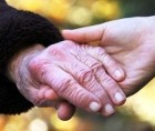 Joined hands of an older and a younger woman
