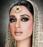 Beautiful woman with lavish jewellery and richly embroidered head veil